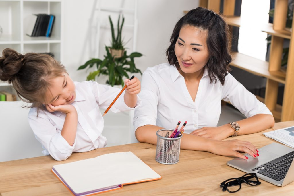 Mother and daughter studying at the desk